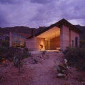 Tucson Mountain House, Tucson, Arizona, 2001  Rick Joy Architects © Undine Pröhl, photographer, courtesy National Building Museum The rammed earth walls of the Tucson Mountain House absorb heat during the day and gradually warm the interior as temperatures plummet at night. On the north side of the house, an expansive porch with fireplace, lounge, and views, functions as an outdoor room.
