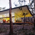Walla Womba Guest House, Bruny Island, Tasmania, Australia, 2003 1+2 Architecture Photo by Peter Hyatt, courtesy National Building Museum  The Walla Womba Guest House utilizes a raised steel frame to sit lightly on its thickly wooded site, and lifts the house to help keep natural drainage patterns intact.