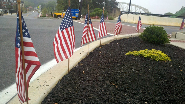 Flags mark where First Lt. Bruce Lawrence's Funeral Procession will pass through Easton tomorrow