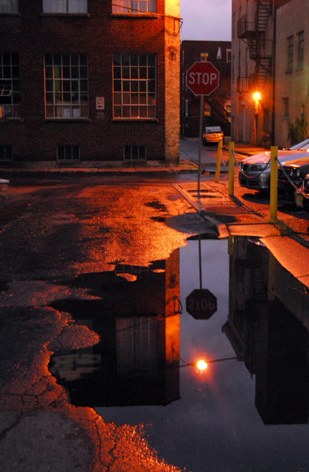 Stop sign and light reflection near the corner of Church and Sitgreaves in downtown Easton, PA. Photo by Laini Abraham